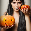 Royalty-Free Stock Photo: Witch and two pumpkins