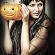 Woman witch holding pumpkin — Stok fotoğraf