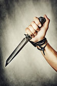 Knife in hand — Stock Photo