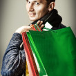 Fashion man holding shopping bags — Stock Photo
