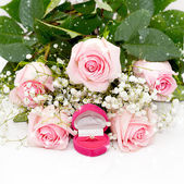Close-up of tender pink roses, diamond ring — Stock Photo