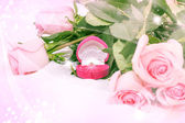 Pink roses with diamond ring — Stock Photo