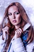 Beautiful woman in white jacket — Стоковое фото