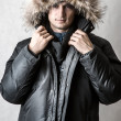 Stock Photo: Man in black fur hood winter jacket