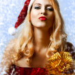 Royalty-Free Stock Photo: Sexy blond woman in santa claus hat