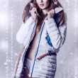 Stock Photo: Beautiful brunette womin white jacket