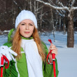 Young smilling woman in winter forest - Stok fotoğraf
