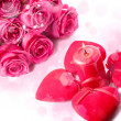 Pink roses, candle and red hearts — Stock Photo #18359833