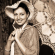 Woman in old hat with a lace umbrella — Stock Photo #18828509