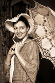 Woman in old hat with a lace umbrella — Stock Photo