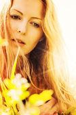Beautiful blonde woman on grass — Stock Photo
