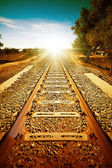 Old railroad to sun light — Stock Photo