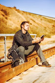 Travelling young man with backpack — Stock Photo