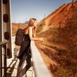 Woman traveler with a backpack — Stock Photo