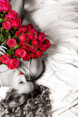 Woman with big bouquet of red roses — Stock Photo