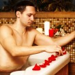 Young man in spa - Stock Photo