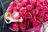 Flowers and ring in pink box — Stock Photo