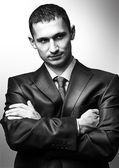 Young handsome man wearing suit — Stock Photo