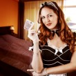 Sexy French Maid holding money — Stock Photo