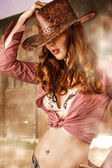 Woman wearing cowboy hat — Stock Photo