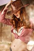 Woman wearing cowboy hat — Stock Photo