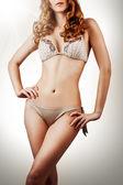 Sexy slim woman in beige bikini — Stock Photo