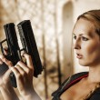 Sexy beautiful woman with guns - Stock Photo