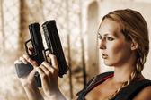Sexy beautiful woman with guns — Stock Photo