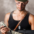 Stock Photo: Military man counting money