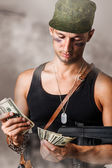 Military man counting money — Stock Photo