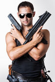 Handsome sexy military man with guns — Stock Photo