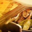 Beautiful young sexy woman in car — Stock Photo