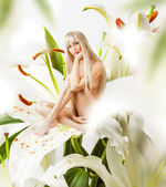 Beautiful sexy woman pixie in flowers — Stock Photo