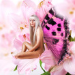 Beautiful sexy woman pixie on flower — Stock Photo #24119697