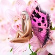 Beautiful sexy woman pixie on flower - Stock Photo