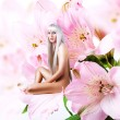 Beautiful sexy woman pixie on flower — Stock Photo #24119783