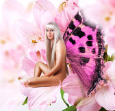 Beautiful sexy woman pixie on flower — Stock Photo