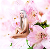Beautiful sexy woman pixie on flower — Stock Photo