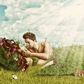 Loving sexy couple lying in bed of grass — Stock Photo