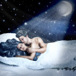 Loving fairy couple in a bed of snow - Stock Photo