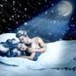 Loving fairy couple in a bed of snow — Stock Photo #25234397