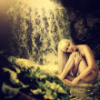 Lagoon, waterfall and sexy blond woman — Stock Photo #26029659