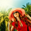 Young beautiful woman on tropical resort — Stock Photo