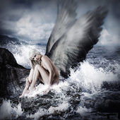 Sexy blond woman with angel wings — Stock Photo