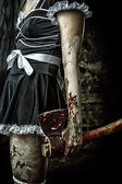 Evil woman holding a bloody ax — Stock Photo