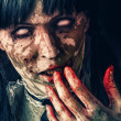 Stock Photo: Scary zombie woman