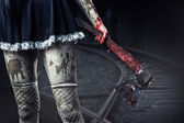 Dirty woman's hand holding a bloody axe — Foto de Stock