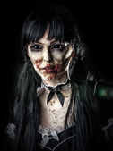 Scary zombie woman with black eyes — Stock Photo