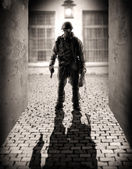 Silhouette of a dangerous military men — Stock Photo