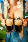 Oktoberfest woman holding two beer mugs — Stock Photo